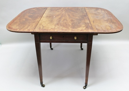A 19TH CENTURY MAHOGANY PEMBROKE TABLE, cross banded top, fitted real and faux drawers on squared, tapering supports, with castors, 91cm