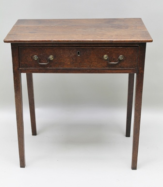 A GEORGE III OAK SINGLE DRAWER SIDE TABLE, raised on squared tapering supports