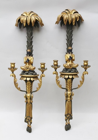 A PAIR OF 20TH CENTURY VENETIAN CARVED EBONISED AND GILTWOOD WALL SCONCES, palm tree crests, over seated Blackamoor musicians, flanked by a pair nozzles on acanthus branches, with drapery below, 83cm high