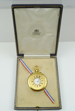 AN 18CT GOLD GENTLEMANS HALF HUNTER POCKET WATCH, the dial with Roman numerals, inset with secondary dial, the front case with blue enamel numerals about a central lenticel, engraved monogram and inscription, engraved to inner dust cover: Presented to Sydney Meddows Taylor (Station Master G.W.R.) by the residents of Bourne End, Bucks., on his leaving the county, as a mark of their high esteem and regard. October 1927. In Elkington and Co., tooled blue leather case