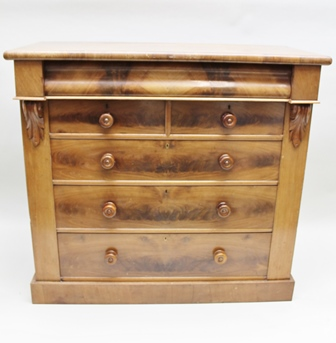 A VICTORIAN MAHOGANY CHEST OF DRAWERS FROM THE NORTH EAST OF ENGLAND, fitted frieze drawer over two short and three long drawers with turned knob handles, leaf mouldings to the carcase, raised on closed plinth base, 123cm wide x 115cm high