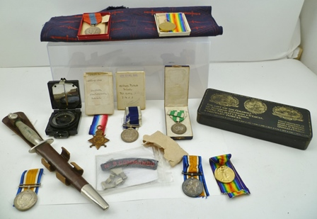 A SMALL ARCHIVE RELATING TO PO.1259 WILLIAM EDWARD PICKETT PRIVATE. R.M.L.I. HIS SECOND WORLD WAR MEDALS, including Long Service, Navy, Imperial Service medal, other medals, with ribbons, various paperwork, both printed and handwritten, a compass, aNo.9 Commando shoulder patch, a piece of fabric printed with a fighting knife, a Trench Art bracelet stamped Anzio, Pisa, Cassino, Naples, Africa, Sicily, Siena, together with a Fairburn-Sykes commando fighting knife, made by Wilkinson Swordof London, 1st pattern nickel plated, with original scabbard having securing tabs