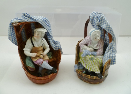 A PAIR OF LATE 19TH CENTURY PORCELAIN FIGURES The Cobbler and his wife, depicted seated in barrel form seats, polychrome painted, incised and blue underglaze factory marks, possibly Meissen, 18cm high