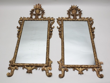 A PAIR OF GEORGIAN DESIGN CARVED GILTWOOD FRAMED PIER MIRRORS, with vase of flowers crest and bound leaf frame, plate size 84cm x 41cm