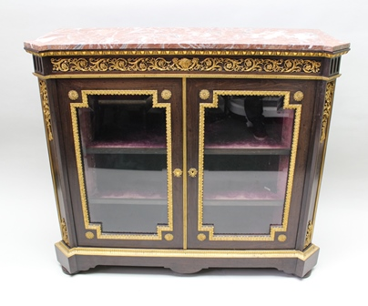 A PAIR OF MID-LATE 19TH CENTURY FRENCH LOUIS XVI STYLE SIDE CABINETS, each fitted a pair of glazed doors, enclosing velvet lined shelves, possibly amboyna veneer, decorative gilt metal mounts, the top fitted with marble tops, 122cm wide