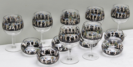 VETRI DARTE FONTANA (Vedar) A SET OF SIX ENAMELLED GLASS GOBLETS (plus one AF) and the MATCHING SET OF SIX FINGER BOWLS decorated with a frieze of putti on a black ground, signed Vedar, glasses 19cm high, circa 1928