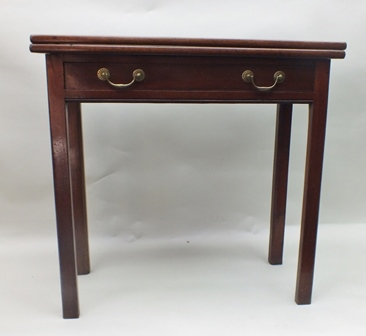 A 19TH CENTURY PLAIN MAHOGANY RECTANGULAR TOPPED FOLD-OVER TEA TABLE with single full width drawer, having original brass swan neck drop handles, supported on four plain canted legs, 76cm wide