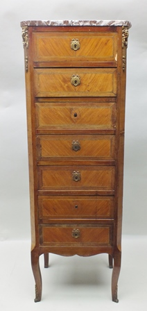 A LATE 19TH/EARLY 20TH CENTURY FRENCH MARBLE TOPPED SEVEN DRAWER CARTONIER with crossbanded kingwood veneered front, having cast brass applied rams head decoration and bow and swag escutcheons, supported on four cabriole stylised legs with cast brass applied feet, 122cm high
