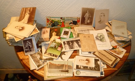 A LARGE QUANTITY OF POSTCARDS includes comic, views etc. including one of a German submarine, also CABINET PORTRAIT PHOTOGRAPHS from circa 1900