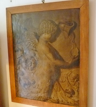 A 19TH CENTURY STUDY OF PLASTER WORK IN TABLATURE featuring cherubs and floral rosette with acanthus leaves, en grisaille Oil painting on canvas, 90cm x 70cm in a plain oak frame