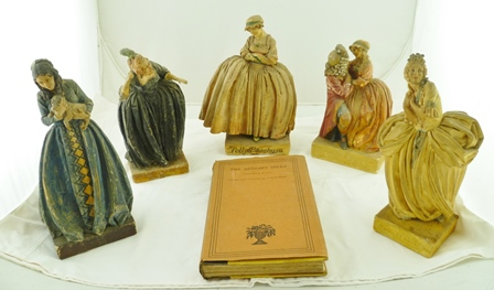 FIVE WAX PAINTED PLASTER CHARACTERS, by Agatha Walker (1888-1980), from The Beggars Opera, (1920 production) some are named, including Polly Peachum and Mrs Sullen together with A COPY OF A BOOK THE BEGGARS OPERA written by John Gay