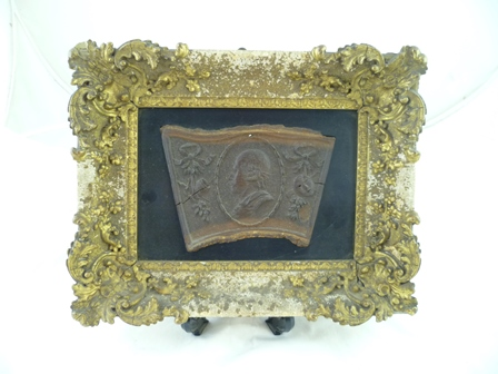 A LATE 18TH CENTURY CARVED MULBERRY WOOD PANEL depicting Shakespeare to the centre, in a raised cameo, oak framed with theatrical devices flanking, mounted within a gilt gesso frame, the reverse bears hand written script A present for the Reverend Mrs Gaskill, owner of the house and garden where the late William Shakespeare had lived in Stratford-upon-Avon She and her husband bought the house in 1753. The Mulberry Tree was cut down in 1756 of which this is reputedly carved, overall dimensionsof outer frame 20cm x 25cm