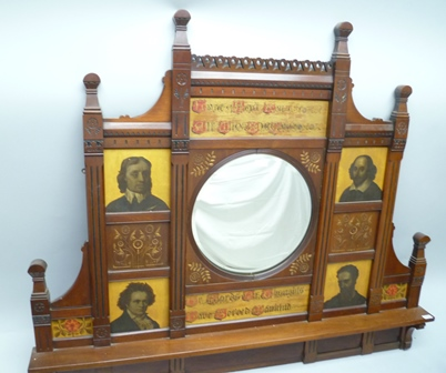 A LATE 19TH CENTURY AESTHETIC DESIGN OVERMANTEL BACK PANEL with central circular bevel-plate mirror, flanked by text and portraits of eminent artists including; Beethoven and William Shakespeare, 153cm wide
