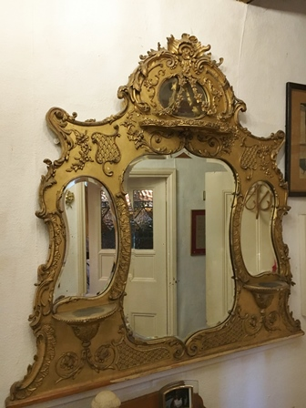 A 19TH CENTURY ORNATE GILT GESSO OVERMANTEL MIRROR with scrolling acanthus crest, inset four bevel cut mirror plates, overall 136cm