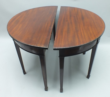 A PAIR OF GEORGIAN DESIGN MAHOGANY D END SIDE/SERVING TABLES each with beaded edge, raised on four square tapering spade feet supports, 105cm wide