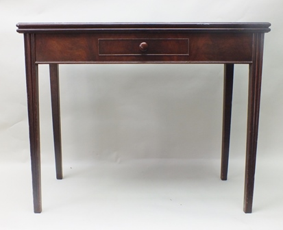 A 19TH CENTURY MAHOGANY RECTANGULAR TOPPED FOLD-OVER TEA TABLE fitted single central drawer with turned knop handle, supported on four carved tapering legs, 91cm wide
