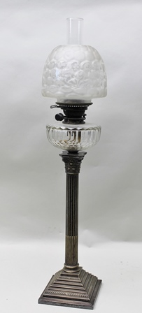 A 19TH CENTURY CORINTHIAN COLUMN OIL LAMP with facet cut glass reservoir, part etched shade, on a stepped base, 84cm high