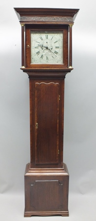 A 19TH CENTURY OAK LONGCASE CLOCK, having silvered dial bearing the name Henry Deykin of Worcester, clock number 1396, plain dial with subsidiary seconds and date aperture, the carcase having blind fret carved frieze, over twin column supports, long crossbanded single door, on a box base, 206cm high