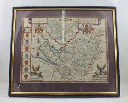 JOHN SPEEDE THE COUNTYE PALANTINE OF CHESTER, an engraved Map, later hand coloured, with plan of the City of Chester, also features the Arms of the Earls of Chester since the Norman Conquest, 38cm x 50cm in an ebonised and gilt frame, glazed verso to reveal text