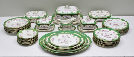 A FIRST QUARTER 20TH CENTURY BISHOP & STONIER POTTERY DINNER SERVICE in a Chelsea stylised pattern comprising 50 pieces, to include; oval serving platters, various size plates and bowls, lidded tureens and a gravy boat