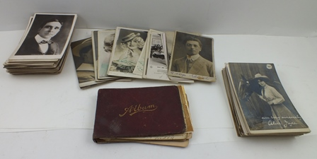 AN AUTOGRAPH BOOK OF MUSICAL ACT SIGNATURES, with sayings and some sketches, together with a quantity of THEATRICAL AND MUSIC HALL POSTCARDS, some signed