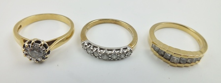 AN 18CT GOLD SOLITAIRE DIAMOND RING, size O, together with TWO 9CT GOLD DIAMOND SET RINGS (3)