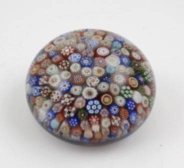 AN EARLY 20TH CENTURY FRENCH MULTI-CANE PAPERWEIGHT, 5.5cm diameter