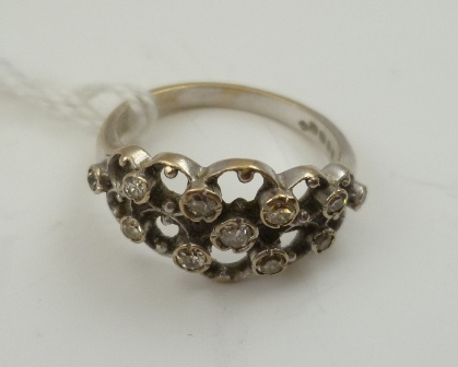 AN 18CT WHITE GOLD LADYS DRESS RING, inset with diamonds all over, size M