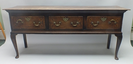 A 19TH CENTURY OAK DRESSER having plain rectangular top over three inlaid in-line drawers, on cabriole forelegs and plain rear, 80cm x 186cm wide