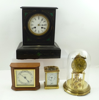 A VICTORIAN BLACK SLATE MANTEL CLOCK, inset malachite panels, circular enamel dial with Roman numerals, 8-day striking movement, 28cm high, together with a CARRIAGE CLOCK, a CLOCK UNDER A GLASS DOME, and ONE OTHER CLOCK (4)