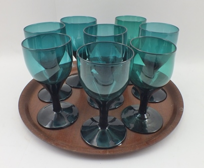 EIGHT GEORGIAN BRISTOL GREEN GLASS WINES, the bowl tapering down into the stem with circular platform foot