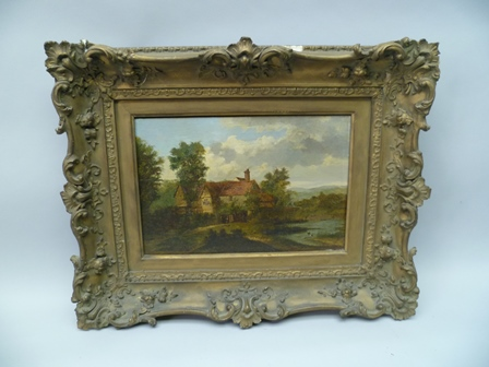 19TH CENTURY EUROPEAN SCHOOL Farmhouse in woodland landscape, an Oil on panel, 26cm x 39cm in an ornate gilt frame