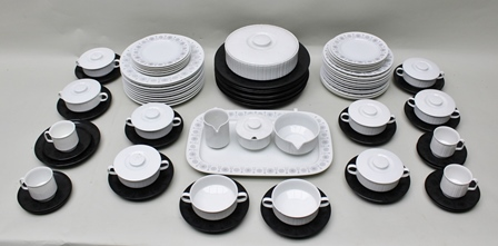 AN EXTENSIVE PORCELAIN COFFEE AND DINNER SERVICE DESIGNED BY TAPIO WIRKKALA FOR ROSENTHAL IN THEIR STUDIO LINE RANGE comprising many cups, saucers, plates, some white and some black with applied sunburst/snowflake decoration