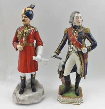 MICHAEL SUTTY A HAND PAINTED CERAMIC MODEL NO. 37 Governors Bodyguard Madras, 30cm high, together with a Continental porcelain FIGURE of a French Military Officer beside a road marker, inscribed Route de Fleurus, 28cm high (2)