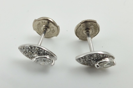 A PAIR OF DIAMOND SET ELIPTICAL EARRINGS (for pierced ears), considered to be white gold mounted, in box of issue