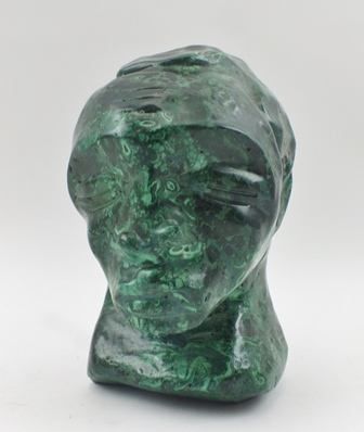 AN AFRICAN CARVED MALACHITE STATUE, head of a man, 13cm high