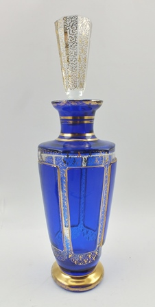 A MOSER CRYSTAL LIQUEUR DECANTER, blue flashed panels, gilded, complete with a tapering hexagonal clear stopper, also gilded, overall height 29.5cm