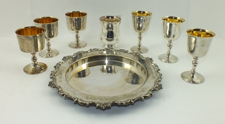 SIX SILVER GOBLETS, limited editions by Barker Ellis, to commemorate anniversaries of Worcester and York cathedrals, gilded interior to the bell form bowls, knopped stems, on platform bases, Birmingham 1971, 138g each, with certificates, boxed, together with a PLATED SALVER AND TANKARD