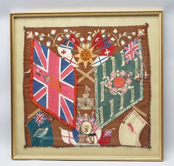 A NORTH DEVON REGIMENT WOOL WORK PICTURE circa 1900, depicts banner with honours, Pyrenees, Afghanistan, etc., inset a photograph of a soldier in uniform, wool work 70cm x 73cm in gilt glazed frame