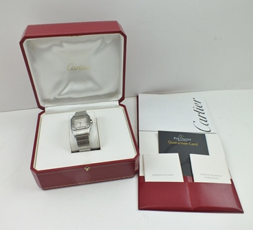 A CARTIER SANTOS STAINLESS STEEL LADYS BRACELET WRIST WATCH, having square face with Roman numerals and date aperture, automatic movement, screwed down bezel, no. 380666CD, in original box with booklet, paperwork, guarantee card, receipt etc.