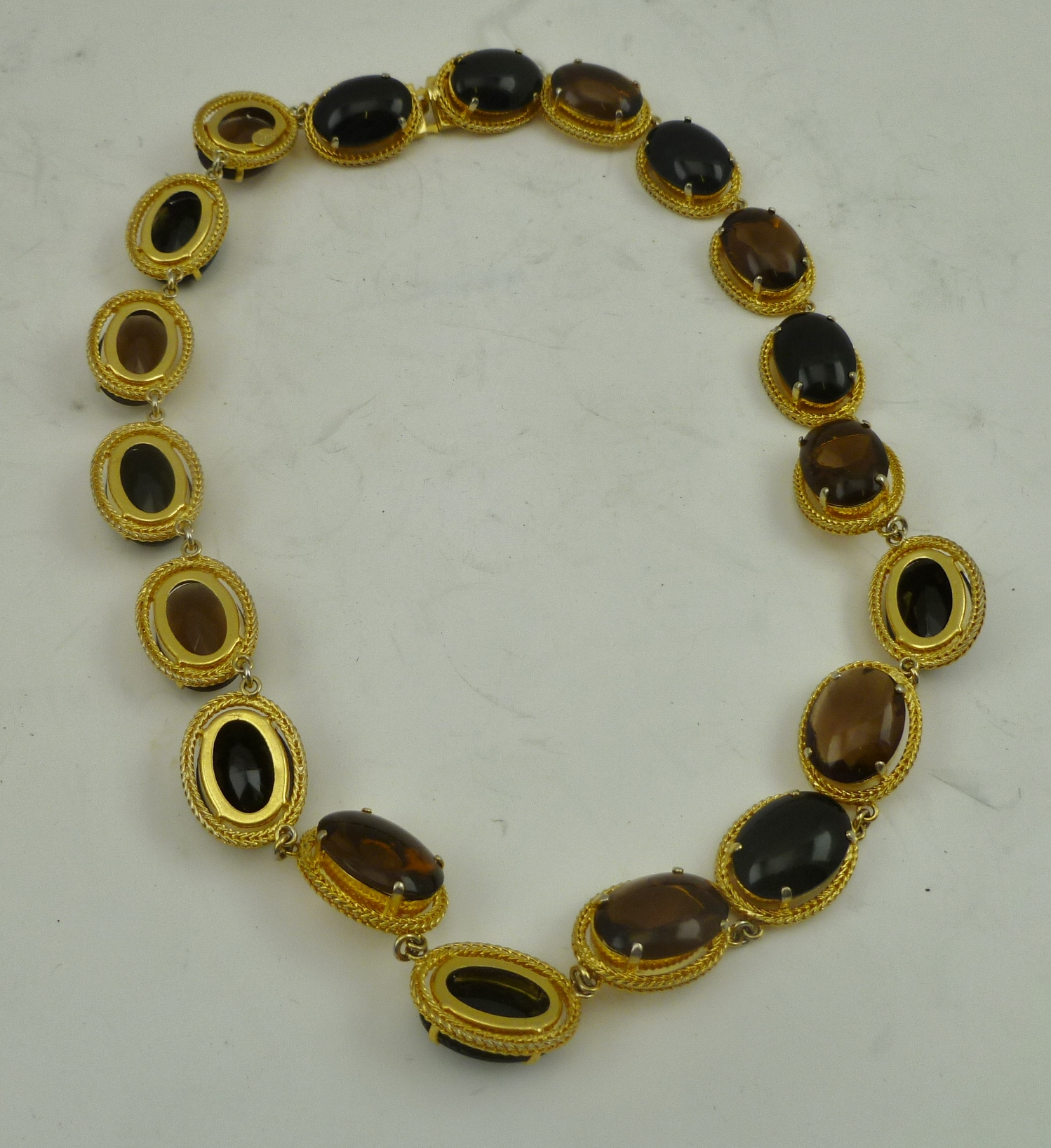 A CHRISTIAN DIOR, HENKEL AND GROSSE NECKLACE, the gilt metal links set cabochon black amber glass beads (purchased by vendor in 1963)