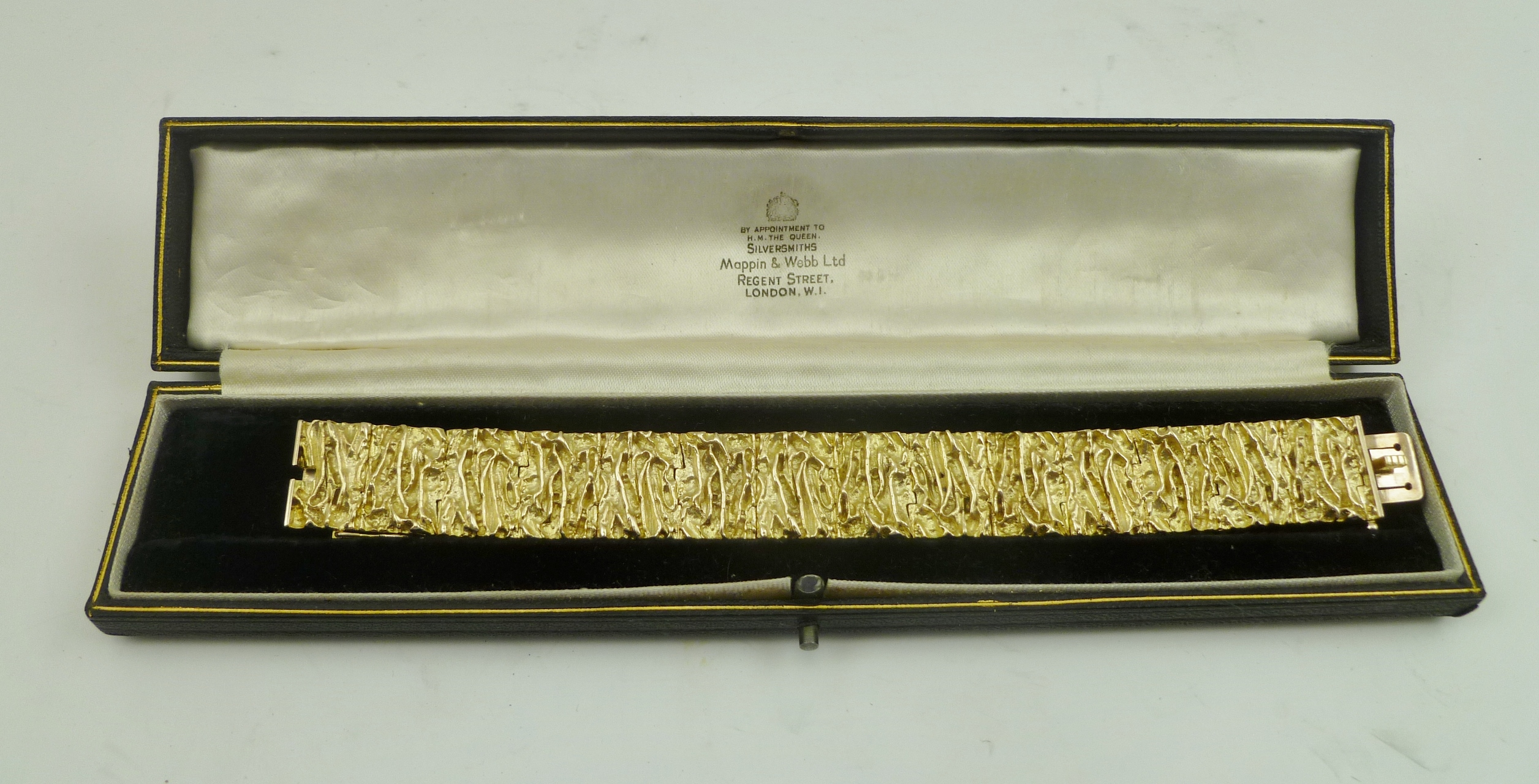 A 9CT GOLD BRACELET, formed from cast bark effect links, (purchased by vendor in 1968), weight 68g