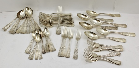 A QUANTITY OF AMERICAN WHITE METAL FLATWARE, decoratively cast, comprising six table spoons and ten of each dessert spoons, teaspoons, table forks and dessert forks, marked Sterling pat.1885, together with a few extra item, combined weight 2565g