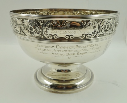 THOMAS LATHAM & ERNEST MORTON AN EDWARDIAN SILVER TROPHY BOWL, repousse rim with birds amidst acanthus leaves, Chester 1904, 18cm diameter, 487g, engraved Birmingham Columbarian Challenge Bowl - for best Carrier, Pouter, Barb, Dragoon, Antwerp andShow Homer - Young Bird Show, (with association to the eminent pigeon fancier Henry Allsop)