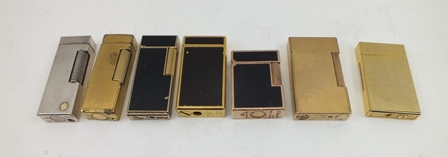 A COLLECTION OF SEVEN VARIOUS CIGARETTE LIGHTERS, includes Dunhill, Dupont etc. (7)
