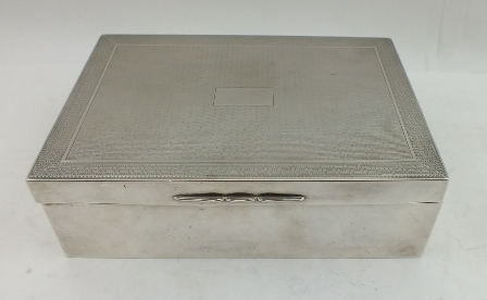 CHARLES S GREEN & CO A SILVER PLAYING CARD BOX, having engine turned hinged cover with Greek key border, opens to reveal green leather interior with two divisions for cards, Birmingham 1902, 15.5cm wide