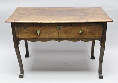 A PART 18TH CENTURY CONTINENTAL OAK LOWBOY, having single drawer, raised on square section cabriole legs with block feet, 110cm wide