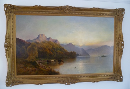 ALFRED DE BREANSKI, SNR (1852-1928) Sunrise Windermere, with cattle watering in the foreground, Oil on canvas, signed lower right, 73cm x 124cm in ornate gilt frame