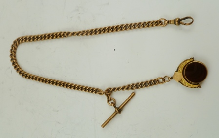 A 9CT ROSE GOLD WATCH CHAIN with 9ct gold T-bar, suspending a 9ct gold reversible stone set fob
