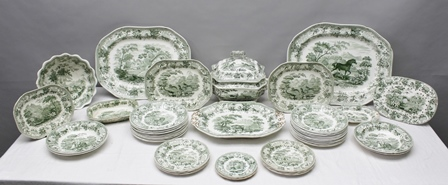 A PART 19TH CENTURY POTTERY DINNER SERVICE Copeland and Garrett late Spode, Aesops Fables design, transfer printed in green, various scenes named verso include; The Fox and the Grapes, The Stag looking into Water, The Lion in Love etc., comprising; vegetable tureen with cover, a salad bowl, mazarin drainer, graduated meat and game serving platters, twenty-one 25cm diameter plates, eight 21.5cm diameter plates etc., 48 pieces